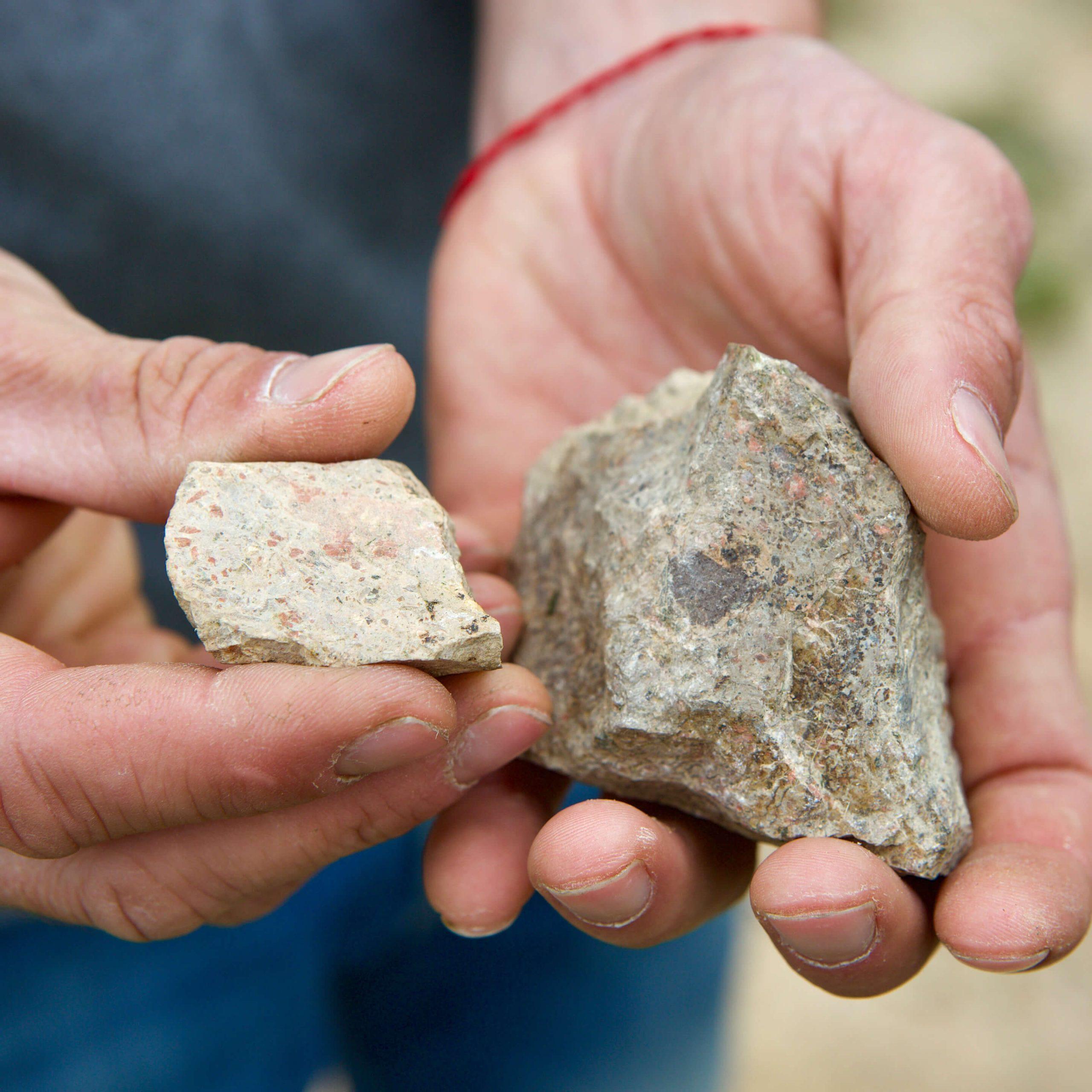 Volcanic rocks from Davide Carlone's vineyards in Boca, Alto Piemonte, and the hands of Cristiano Garella.
